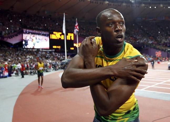 Усэйн Болт выиграл забег солимпийским рекордом