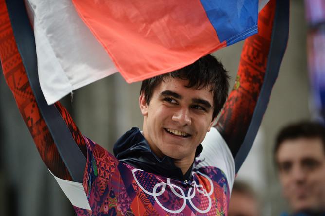 Никита Трегубов (Россия) на финише в финальном заезде на соревнованиях по скелетону среди мужчин на...