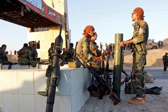 Бойцы пешмерга около иракского Киркука, 20 октября 2017 года