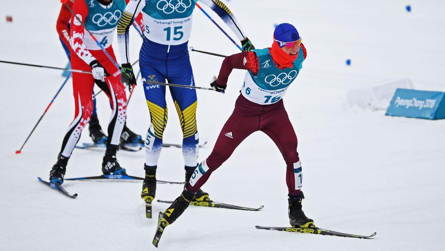 Российский лыжник Денис Спецов (первый)