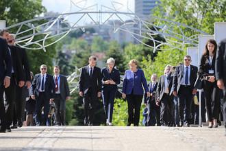 Президент Франции Эммануэль Макрон, премьер-министр Великобритании Тереза Мэи и канцлер ФРГ Ангела Меркель, 17 мая 2018