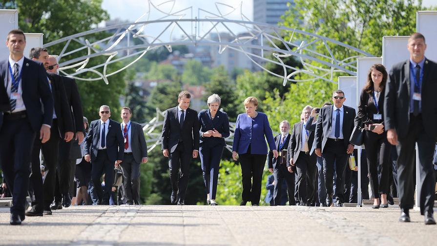 Президент Франции Эммануэль Макрон, премьер-министр Великобритании Тереза Мэи и канцлер ФРГ...