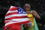 Болт и бронзовый призер американец Джастин Гэтлин