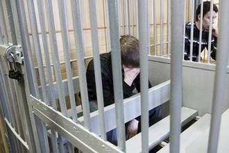 Артем Ануфриев и Никита Лыткин (слева направо), обвиняемые в серии многочисленных убийств, во время оглашения приговора в Иркутском областном суде