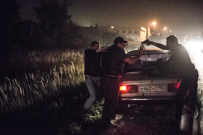 Участники рейда во время поиска банды GTA