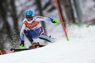 Павел Трихичев (Россия) на трассе слалома в первой попытке на соревнованиях по горнолыжному спорту среди мужчин