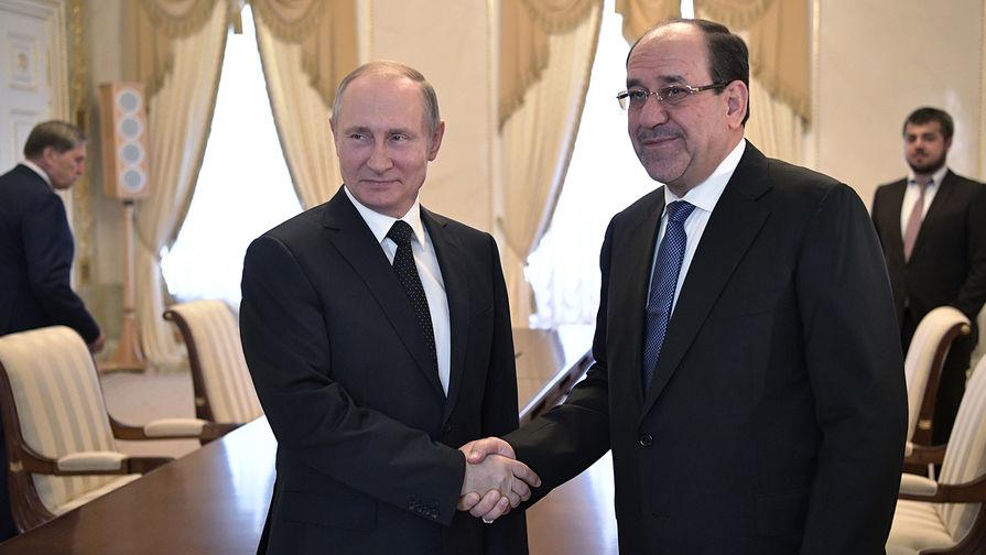 Президент России Владимир Путин и вице-президент Ирака Нури аль-Малики во время встречи в Санкт-Петербурге, 25 июля 2017 года