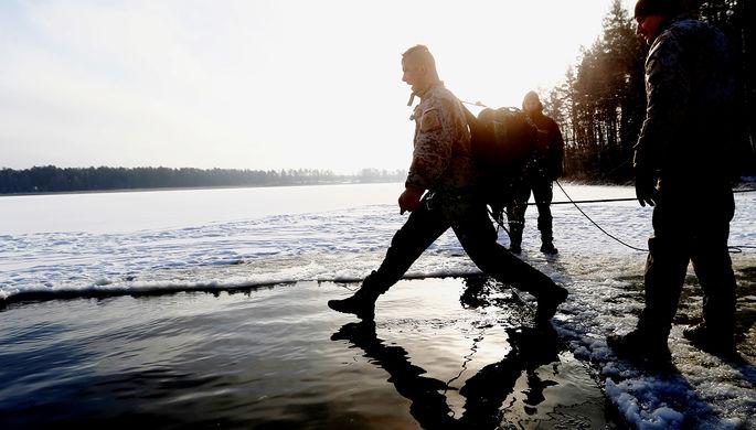 Военнослужащий во время учений НАТО в Адажи, Латвия, февраль 2018 года