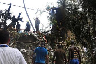 Последствия крушения самолета Boeing 737 около аэропорта в кубинской столице Гаване, 18 мая 2018 года