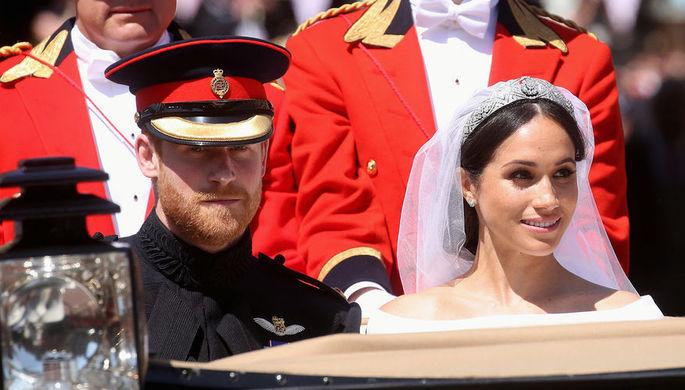 Принц Гарри и Меган Маркл после свадебной церемонии в Виндзорском замке, 19 мая 2018 года