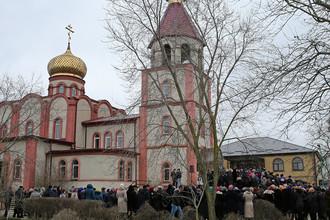 Прощание с погибшими в результате стрельбы у православного храма в Кизляре, 20 февраля 2018 года