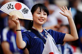 Болельщица сборной Японии перед матчем между командами из Японии и Колумбии на чемпионате мира по футболу в Саранске, 19 июня 2018 года