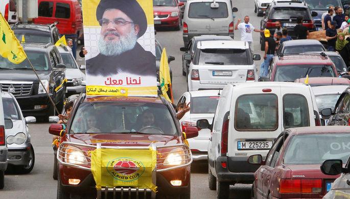 Автомобиль с портретом лидера «Хезболлы» Хасана Насраллы в городе Бинт-Джубайль на юге Ливана во время парламентских выборов в стране, 6 мая 2018 года
