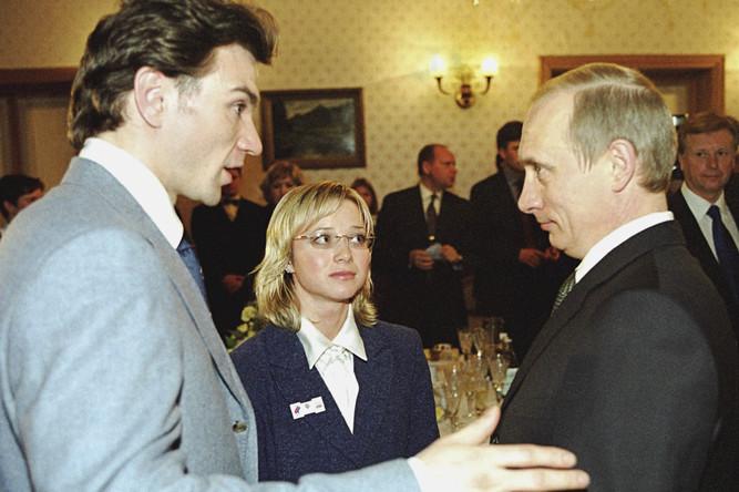 Елена Бережная и Антон Сихарулидзе с президентом Владимиром Путиным в Ново-Огарево, 2002 год