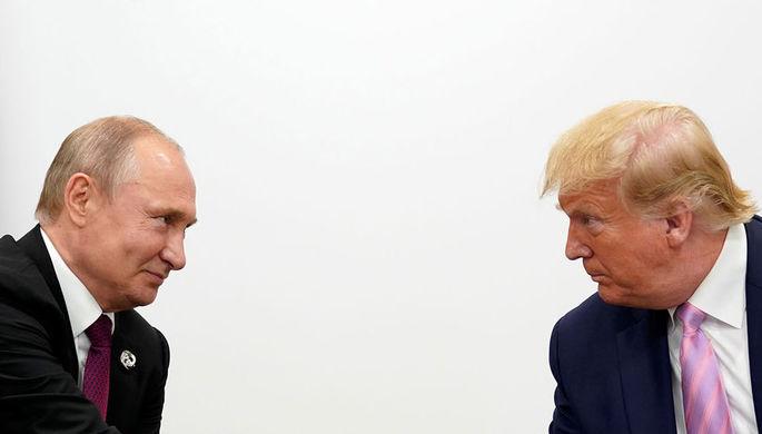 Президент России Владимир Путин и президент США Дональд Трамп во время встречи на полях саммита G20 в Осаке, 28 июня 2019 года