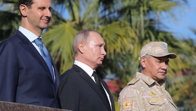 Президент Сирии Башар Асад, президент России Владимир Путин и министр обороны России Сергей Шойгу...