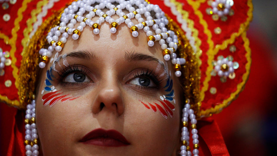 A fan of the Olympic athletes from Russia watches warm-ups before the... 9
