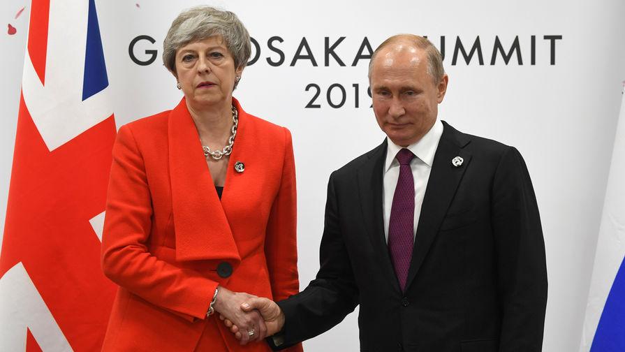 Премьер Великобритании Тереза Мэй и президент России Владимир Путин во время встречи на полях саммита G20 в Осаке, 28 июня 2019 года