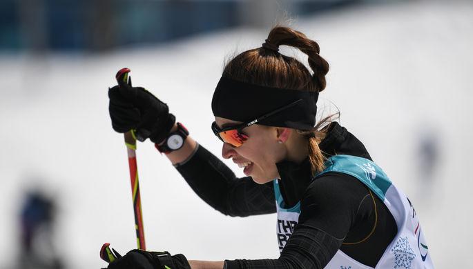 Российская биатлонистка Михалина Лысова на дистанции 6 км в соревнованиях среди слабовидящих на...