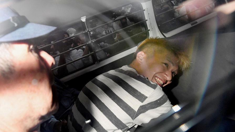 Сатоси Уэмацу в полицейской машине после задержания
