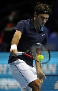 Роже Федерер в матче с Марди Фишем