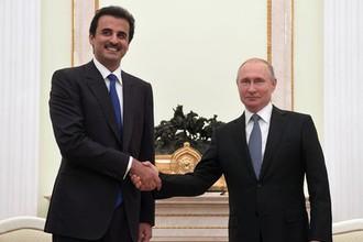 Президент России Владимир Путин и эмир государства Катар шейх Тамим бен Хамад Аль Тани