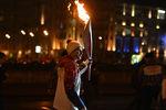 Телеведущий Дмитрий Борисов во время эстафеты олимпийского огня вМоскве, 2013 год