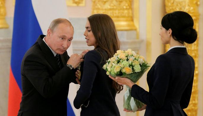 Путин наградил олимпийцев