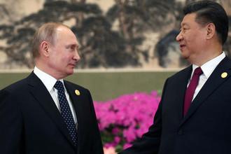Президент России Владимир Путин и председатель Китайской народной республики (КНР) Си Цзиньпин во время встречи в Пекине, 26 апреля 2019 года