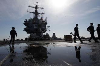 Подготовка авианосца USS Enterprise к последнему плаванию на базе Норфолк, штат Виргиния, март 2012 года
