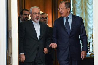 Министр иностранных дел РФ Сергей Лавров (справа) во время встречи с министром иностранных дел Ирана Мохаммадом Джавадом Зарифом.
