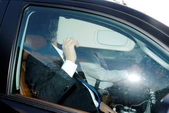 Экс-глава предвыборного штаба Дональда Трампа Пол Манафорт покидает свой дом в Александрии, штат Вирджиния