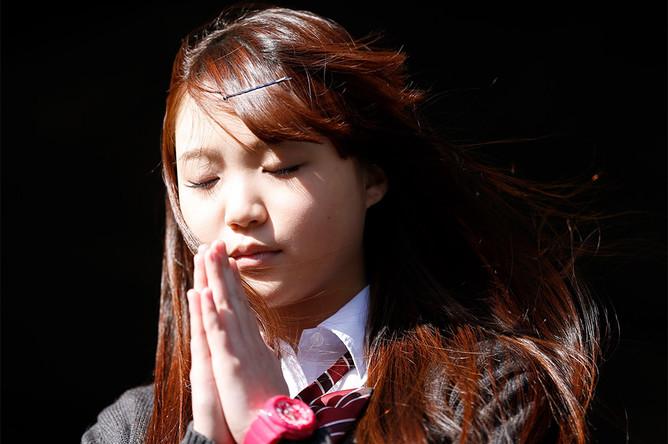 Во время траурных мероприятий, приуроченных к третьей годовщине землетрясения и цунами в Японии