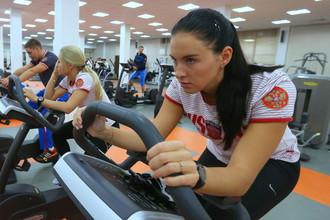 Мария Комиссарова во время подготовки к зимним Олимпийским играм в Сочи