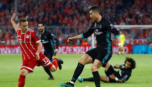 Криштиану Роналду (справа) не смог забить в Мюнхене, в отличии от Йозуа Киммиха, но преимущество...