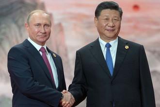 Президент РФ Владимир Путин и председатель КНР Си Цзиньпин, 10 июня 2018 года