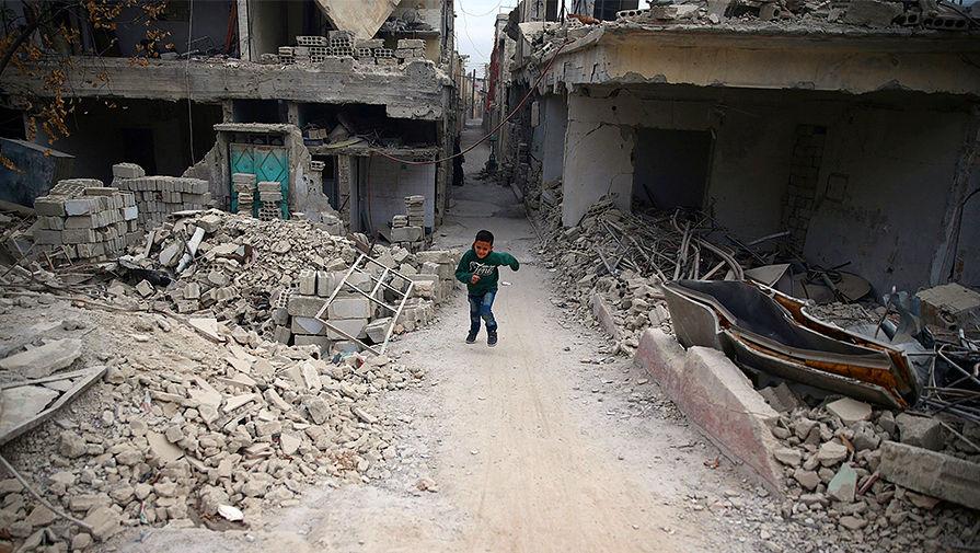 Разрушенные здания в городе Дума близ Дамаска, 13 ноября 2016 года