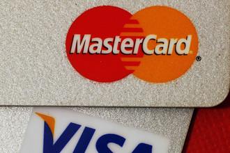 Visa и MasterCard согласились выплатить ритейлерам $6 млрд