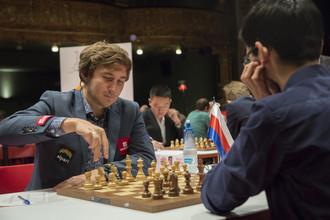Сергей Карякин (слева) во время второй партии турнира в Бильбао