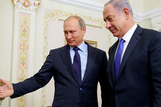 Президент России Владимир Путин и премьер-министр Израиля Биньямин Нетаньяху (слева направо) во время встречи в Ново-Огарево