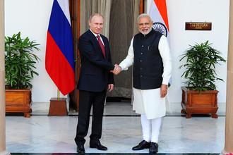 Президент России Владимир Путин и премьер-министр Индии Нарендра Моди во время встречи