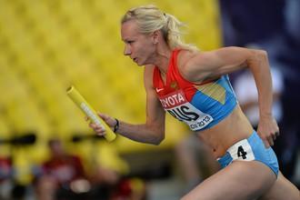 Россиянка Юлия Гущина в финальном забеге эстафеты 4х400 м среди женщин на чемпионате мира по легкой атлетике в Москве.