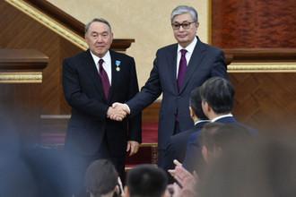 Нурсултан Назарбаев и Касым-Жомарт Токаев (справа), 20 марта 2019 года