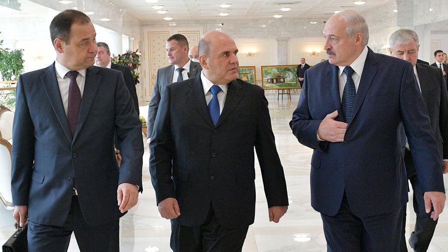 Председатель правительства РФ Михаил Мишустин и президент Белоруссии Александр Лукашенко (справа) во время встречи в Минске, 3 сентября 2020 года