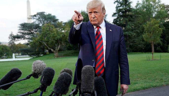 Президент США Дональд Трамп во время общения с прессой на южной лужайке Белого дома, 12 сентября 2019 года