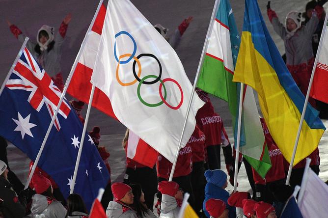 Участники церемонии закрытия XXIII зимних Олимпийских игр в Пхенчхане