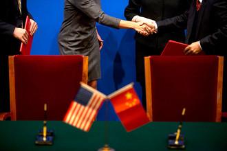 В 2014 году экономике США обещают прорыв, а Китаю — кризис