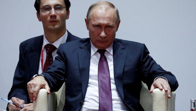 Президент России Владимир Путин во время посещения соревнований Международного турнира по дзюдо...