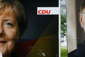 Постеры с изображением лидера «Христианско-демократического союза Германии» Ангелы Меркель и председателя «Социал-демократической партии Германии» Мартина Шульца во Франкфурте, сентябрь 2017 года