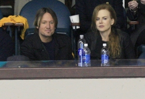 Актриса Николь Кидман и ее муж Кейт Урбан на матче